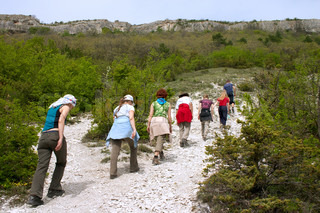 tourists walking up on excursion in the mountains