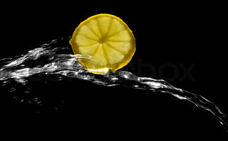 lemon with splashing water on a black background