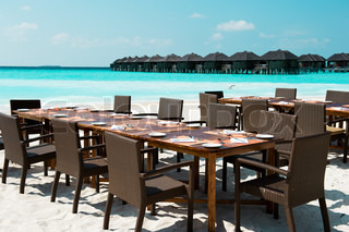 Table and chairs on exotic beach