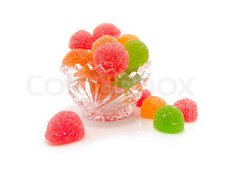 Colour fruit candy in a crystal vase on a white background