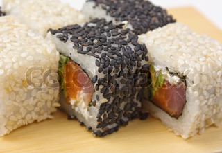 Traditional Asian food sushi on wooden plate