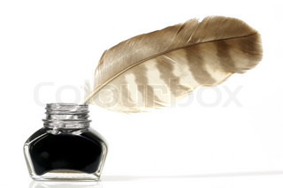 Pinfeather in an inkpot - isolated on white