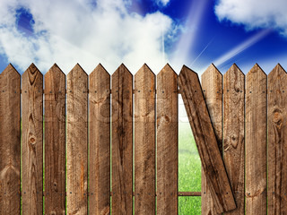 wooden fence over the backyard with sky and sun