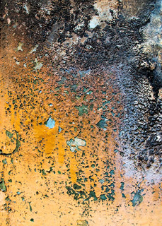 Abstract grunge background from weathered painted, stained, scratched and burned surface of metal