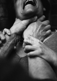 ©Laurent Hamels/AltoPress/Maxppp ; Hands strangling woman, close-up, b&w