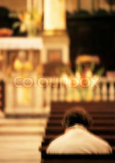 ©Marie Docher/AltoPress/Maxppp ; Person sitting in church, rear view, blurred