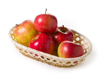 Ripe apples in basket on a white background. Isolated path included.