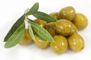 Green olives with olive branch on white background