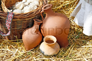 Handmade clay pots on straw - outdoor shot