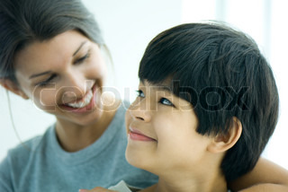 ©Michèle Constantini/AltoPress/Maxppp ; Boy looking over shoulder at sister, both smiling