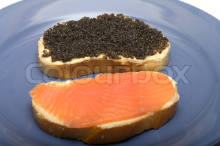 Sandwiches with red fish and black caviar on a blue plate for Black caviar fish