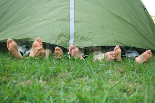 ©Odilon Dimier/AltoPress/Maxppp ; Young friends in tent, feet sticking out
