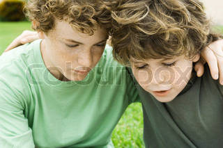 ©Odilon Dimier/AltoPress/Maxppp ; Two boys, arms around each other's shoulders
