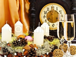 New Year composition with old clock, champagne, balls and garland with candles