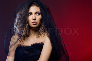 beautiful woman with black veil
