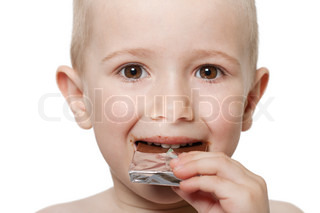 Little child holding sweet chocolate candy food