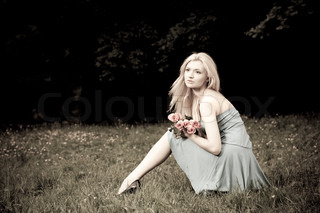 Pretty Woman Sitting OnThe Meadow