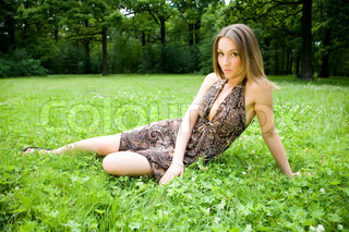 Pretty Woman Laying On A Grass