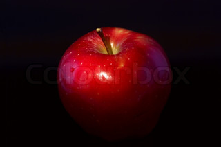 apple on a black background