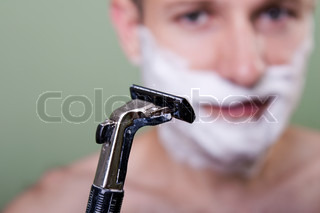 Beauty men with razor shaving blade cutting hair
