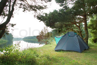 Tourist camping in the wilderness at the river