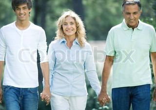 ©Eric Audras/AltoPress/Maxppp ; Mature couple holding hands with teenage grandson