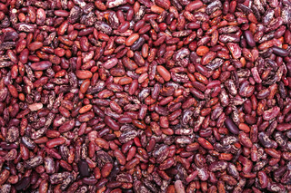 Healthy eating red raw legume bean food background
