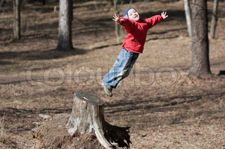 Fun jump - little sport child high jumping up long