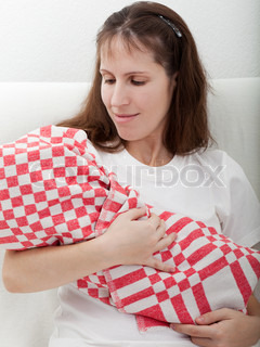 People family love - mother holding newborn baby