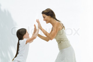 ©Eric Audras/AltoPress/Maxppp ; Mother and daughter playing clapping game together