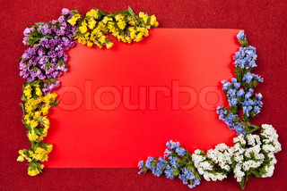 Red paper blank on red with flowers design