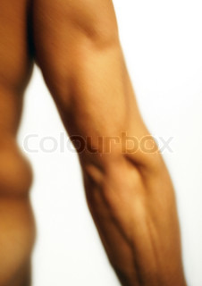 ©Vera Atchou/AltoPress/Maxppp ; Man's flexed triceps, blurred, close-up.
