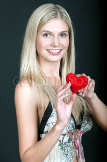 Pretty young woman with red heart