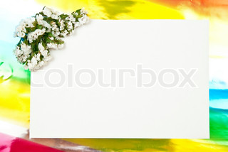 White paper blank on red with flowers design on colored background