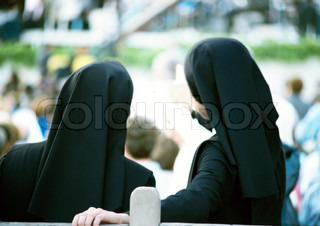 ©Marie Docher/AltoPress/Maxppp ; Two nuns standing side by side, overlooking crowd, rear view