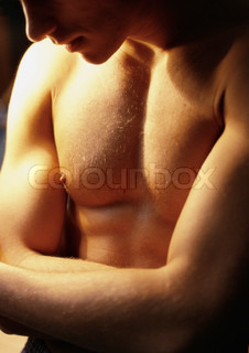 ©Vera Atchou/AltoPress/Maxppp ; Barechested man crossing arms, close-up