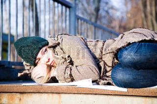 The Young Woman Lying On Asphalt. Economic crisis series.