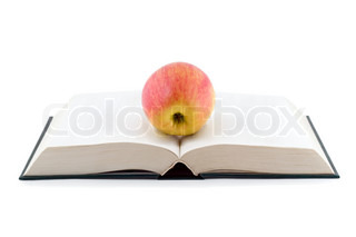 apple on opened book isolated on white background