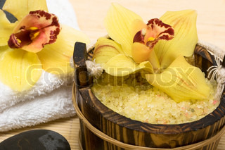 Spa essentials (salt for bath, white towel and orchids)