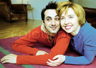 ©Corinne Malet/AltoPress/Maxppp ; Couple lying on floor, smiling.