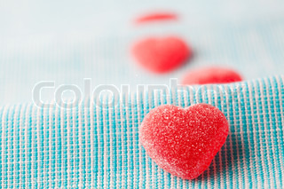 Heart shape candy for Valentine's day on a light blue background
