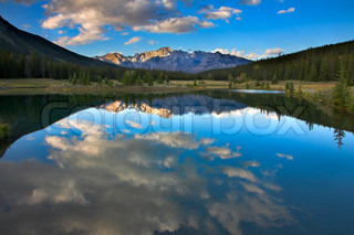 Mirror reflection of the sky and clouds in water of mountain northern lake stock photo colourbox - Impressive house with tranquil environment to get total relaxation ...