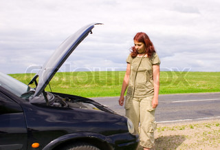 Woman and car on road