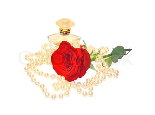 Perfume, pearls and red rose isolated on white