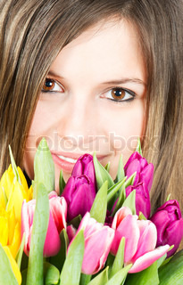 Portrait of young woman with colorful tulips