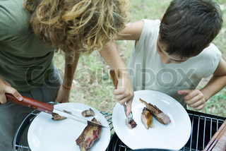 ?Ale Ventura/AltoPress/Maxppp ; Boys sharing piece of grilled meat