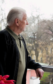 a senior is lonely, depressed, sad case of window