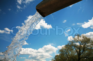 Pure water on a background of the blue sky