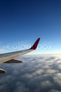 Flying above the sky. Wing of airplane.