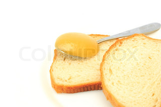 white bread with a honey on the spoon